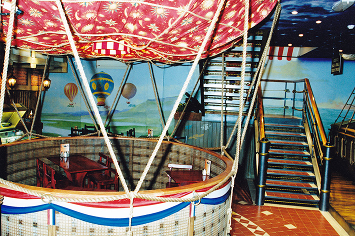 Balloon seating area in themed restaurant